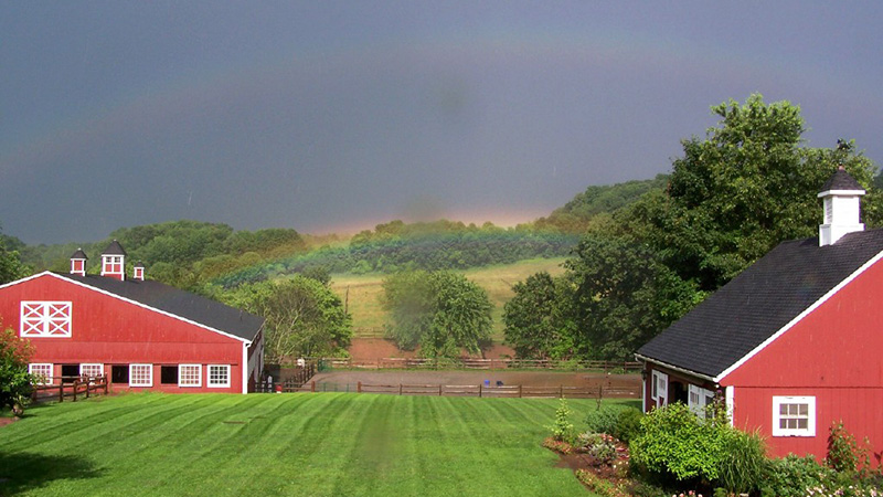 Beautiful Barn with Rainbow Above