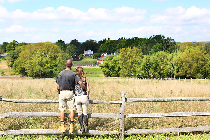 Roger and Lisa Overlooking Farm