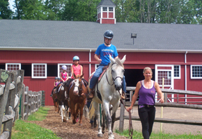 Camp Councilors with Horses